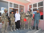 """This is the day we signed the contract (red folder) to approve the road to women's center in Afghanistan. I'm with the DOWA (Director of Women's Affairs in Samagan) and also a U.S. led FET (Female Engagement Team). To my right is a Finnish solider providing security for us and a member of the Afghan Local Police. """