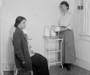 Birth control activists Margaret Sanger and Fania Mindell inside the Brownsville birth control clinic, circa October 1916