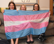 Monica Helms (right) holding up her Transgender Pride Flag