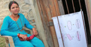 A community health worker teaches how to make cloth pads. Photo: Nyaya Health